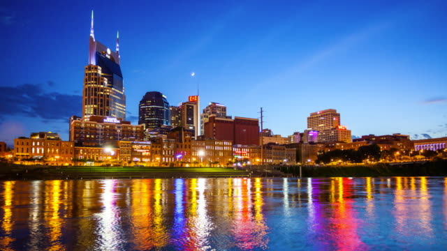 nashville, tennessee city skyline - day to night time lapse - nashville stock videos and b-roll footage