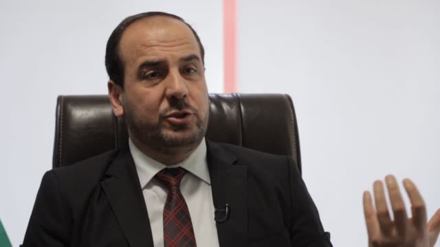 nasr hariri, the head of the opposition syrian negotiation commission , has hailed turkish efforts for maintaining the sochi ceasefire deal on the... - istanbul province stock videos & royalty-free footage