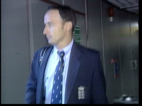 nasser hussain resigns as england captain lib hussain along at airport on return from cricket tour lib buckingham palace hussain posing with obe award - order of the british empire stock videos and b-roll footage