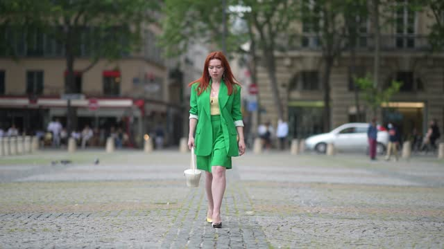 nastasia iavorscaia wears earrings, a necklace, a green oversized blazer jacket from aggi poland, a pale yellow top from jacquemus, green suit... - green colour stock videos & royalty-free footage