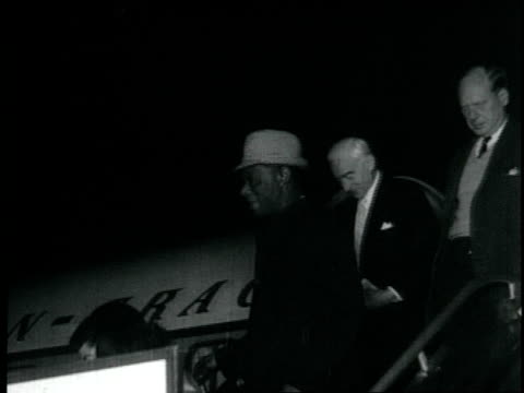 nat king cole arrives in peru steps off pangera airlines airplane greeted by fans at airport people dancing in his honor nat king cole visits peru on... - 1959 stock videos & royalty-free footage