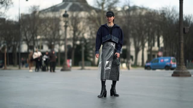natalia modenova wears a blue cap a blue jacket a plastic skirt black shoes outside chanel during paris fashion week haute couture spring/summer 2018... - plastic cap stock videos & royalty-free footage