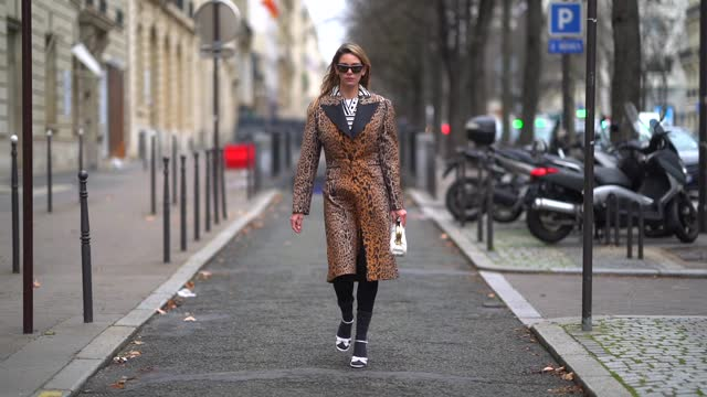 natalia verza aka mascarada wears sunglasses, a total miu miu look made of a black and white striped shirt, a brown leopard print long trench coat... - fashion stock videos & royalty-free footage