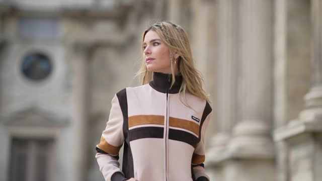 natalia verza wears gold large pendant earrings, a beige ribbed with black ribbed turtleneck zipper pullover with one camel and one dark brown suede... - braided hair stock videos & royalty-free footage