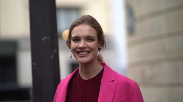 Natalia Vodianova wears a pink blazer jacket a burgundy red dress outside Valentino during Paris Fashion Week Haute Couture Fall Winter 2018/2019 on...