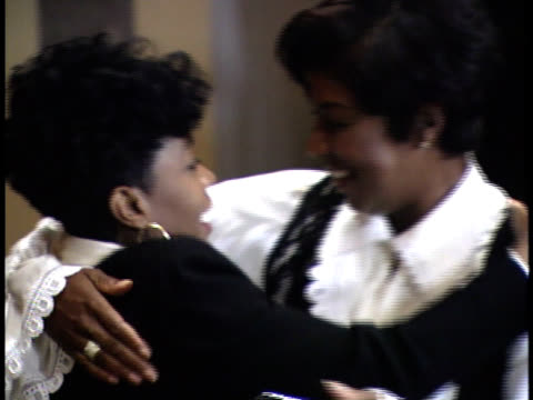 natalie cole and anita baker hug each other on stage - friars roast 1993 stock videos and b-roll footage