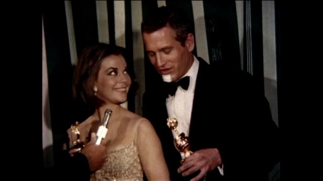 Natalie Wood and Paul Newman win Golden Globes for World's Favorite Actress and Actor at the 1966 Golden Globe Awards held at the Ambassador Hotel...