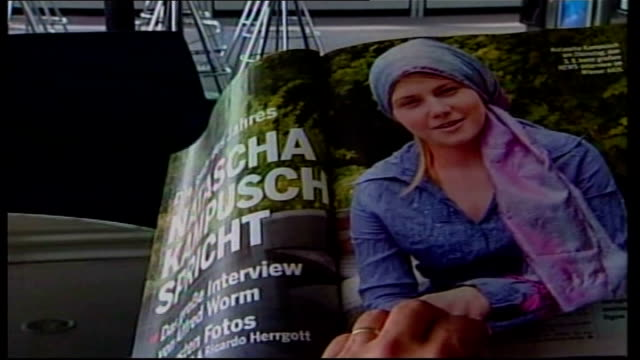 stockvideo's en b-roll-footage met natascha kampusch first television interview int hands turning pages of magazine showing natascha kampusch interview - oostenrijk