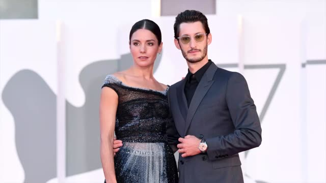 venice italy september 03 natasha andrews and pierre niney walk the red carpet ahead of the movie amants at the 77th venice film festival at on... - gif stock videos & royalty-free footage