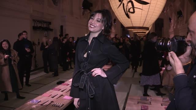 Natasha Andrews Pierre Niney Caroline de Maigret Daisy Lowe and more front row for the HM Fashion Show in Paris Paris France on Wednesday February 28...