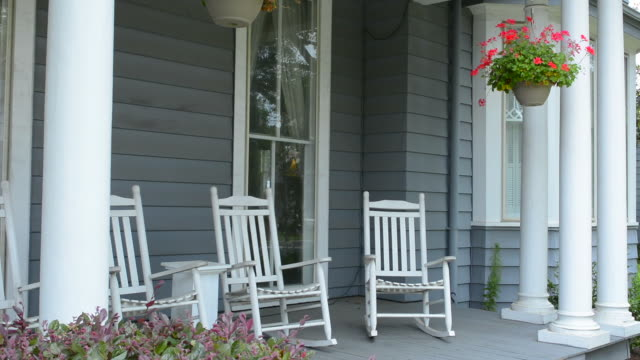 Natchitoches Louisiana porch with rocking chairs moving in Victorian home at Sweet Cane Inn built in 1890 relaxing