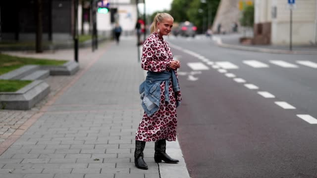 Nathalie Helgerud wearing a dress and a denim jacket is seen outside the 'FWSS' show during Oslo Runway SS19 on August 15 2018 in Oslo 2018 in Oslo...