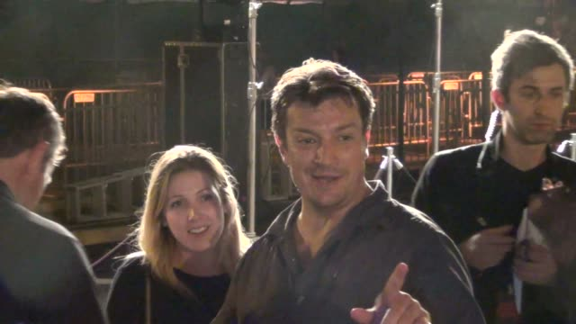 Nathan Fillion has trouble putting on his wristband at Celebrity Sightings ComicCon International 2013 Nathan Fillion has trouble putting on his on...