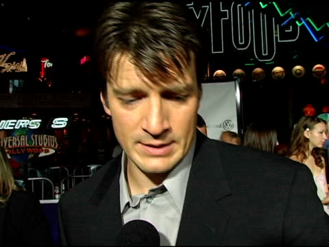 vídeos y material grabado en eventos de stock de nathan fillion on being nervous on his character 'mal' on liking mal even though he wouldn't invite him to a party on the fans reaction to the show... - nathan fillion