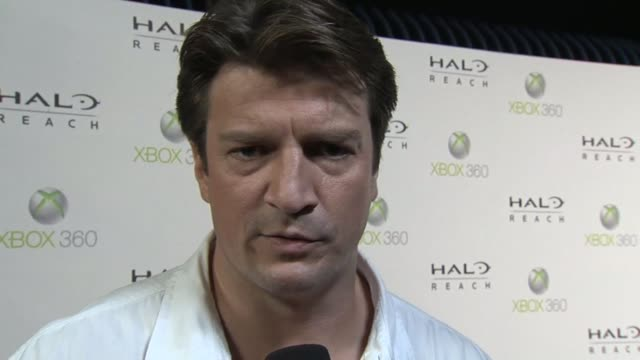 Nathan Fillion on why he thinks the game is sure to be a hit among fans at the 'HaloReach' Midnight Madness Launch Event with Kid Cudi at New York NY