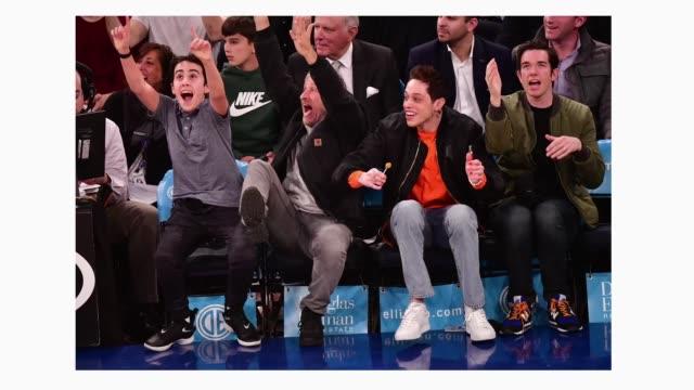 Nathan Stewart Jon Stewart Pete Davidson and John Mulaney attend Chicago Bulls v New York Knicks game at Madison Square Garden on April 1 2019 in New...