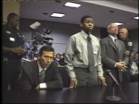 nathaniel brazill and his attorney robert udell stand as the verdict is read after he is convicted of the second degree murder of his teacher barry... - caucasian ethnicity stock videos & royalty-free footage
