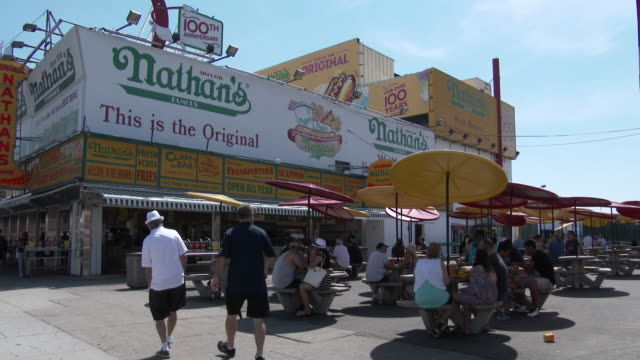 nathan's - coney island, ny (stillwell ave & surf ave) - contestant stock videos and b-roll footage