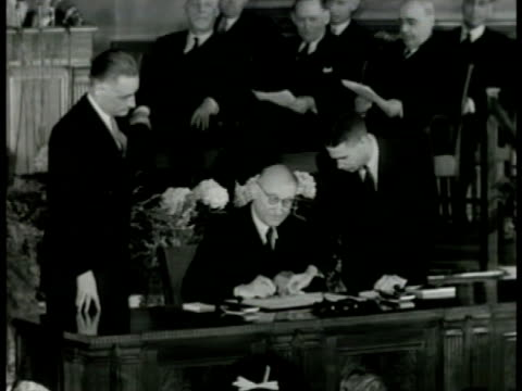 nation flags int ms french foreign minister robert schuman signing treaty ms delegates watching ms italian diplomat carlo sforza signing ws cameramen... - 1949 stock videos and b-roll footage