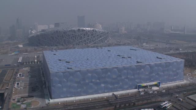 ws ha national aquatics center housing olympic swimming pool and beijing national stadium bird's nest, beijing, china - beijing stock videos & royalty-free footage