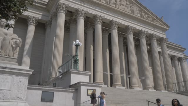 stockvideo's en b-roll-footage met national archives research center on constitution avenue, washington dc, united states of america, north america - national archives washington dc