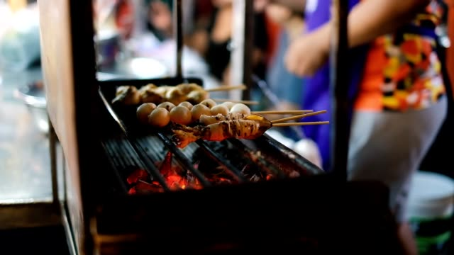 national asian exotic street food on a stick in the showcase of the street night market, surat thani - pattaya stock videos & royalty-free footage