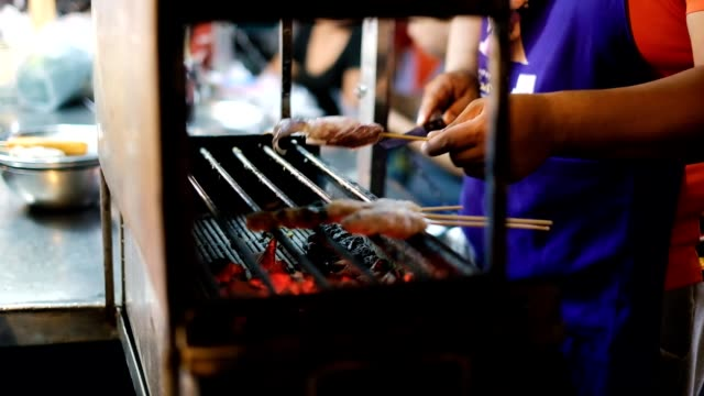 national asian exotic street food on a stick in the showcase of the street night market, surat thani - mollusk stock videos & royalty-free footage