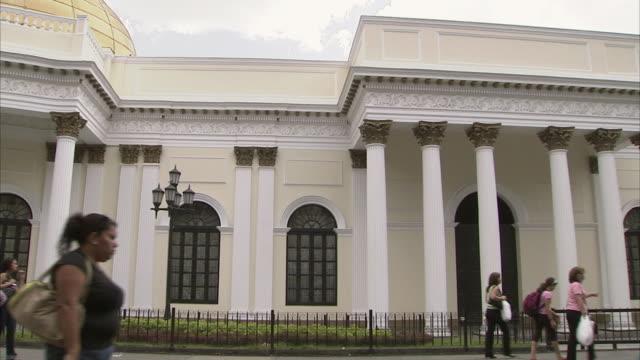 ws pan national assembly building in caracas with pedestrians walking past / metropolitan district of caracas, miranda, venezuela - caracas stock videos & royalty-free footage