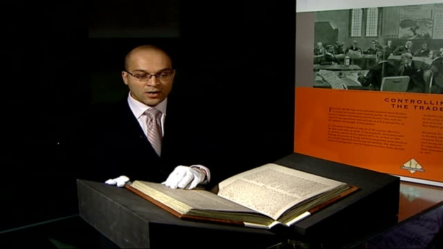 national asset register reveals britain's worth reporter to camera with doomsday book manuscript eddo turning pages of doomsday book - manuscript stock videos and b-roll footage