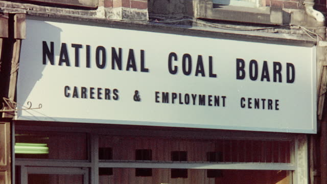 1970 montage national coal board employment center where a prospective young entrant is being interviewed / united kingdom - coal stock videos & royalty-free footage