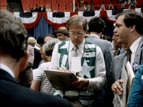 national convention of the us democratic party usa new york int ms ted kennedy posters 'ted quits' lying on seats pan delegates on floor cms anti... - strohhut stock-videos und b-roll-filmmaterial