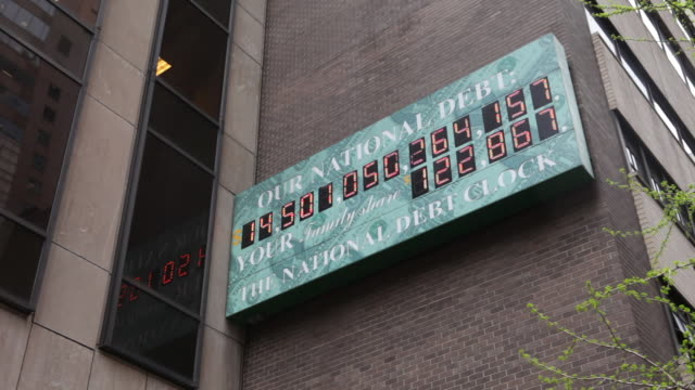 national debt clock with numbers visable - statsskuldklockan bildbanksvideor och videomaterial från bakom kulisserna