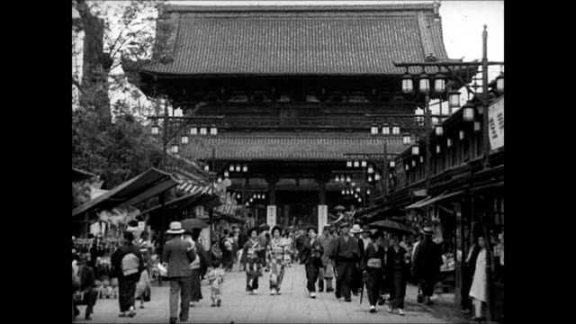 national diet building ws japanese on market street temple bg ws pedestrians women in kimonos entering archway of temple tokyo japan - temple street market stock videos and b-roll footage