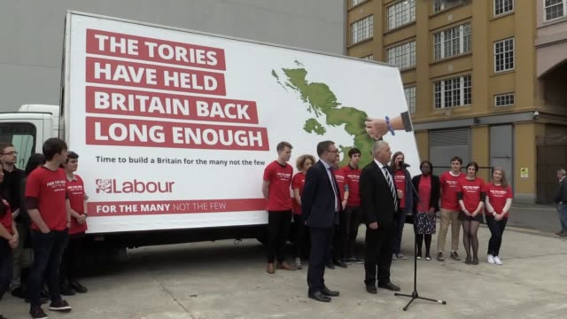 national elections and campaign coordinators ian lavery and andrew gwynne reveal a new poster for labour's general election campaign in london - party poster stock videos & royalty-free footage