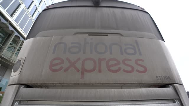 national express bus sits empty on the side of the road on january 10, 2021 in london, england. transport company's national express and megabus to... - sitting stock videos & royalty-free footage