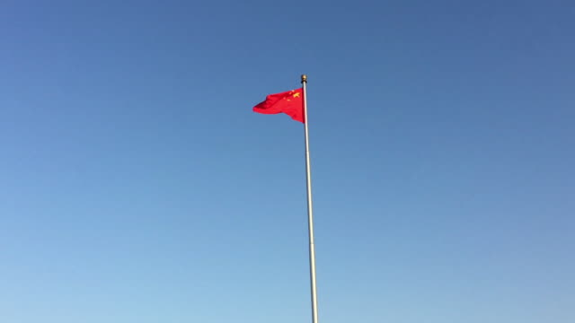 national flag of china blows at tiananmen square on feb 13 2017 in beijing china - chinese flag stock videos & royalty-free footage