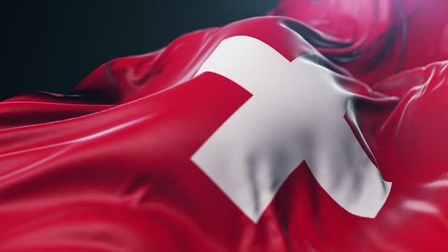 vídeos y material grabado en eventos de stock de primer plano de la bandera nacional de suiza. cámara lenta - cruz forma