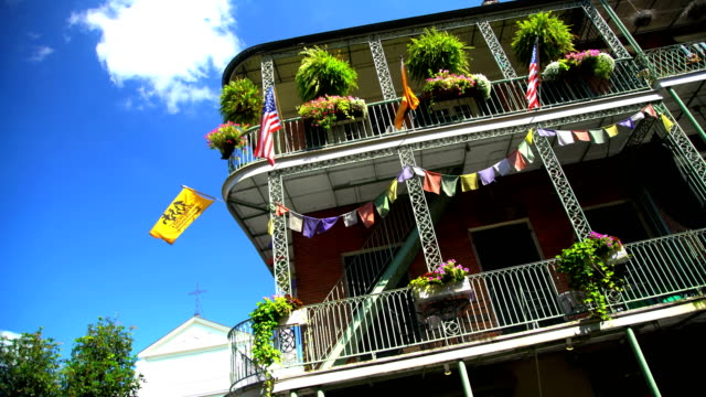 national flags in french quarter downtown new orleans - reportage stock videos & royalty-free footage