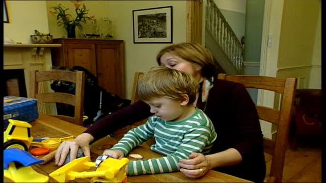 National Food Allergy and Intolerance Week ENGLAND INT Aaron Hamblyn helping his mum Felicity Hamblyn bake a cake in the kitchen Felicity Hamblyn...