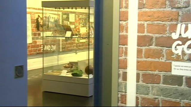 national football museum exhibits football fan memorabilia; england: lancashire: preston: national football museum: ext two football fans looking in... - display cabinet stock videos & royalty-free footage