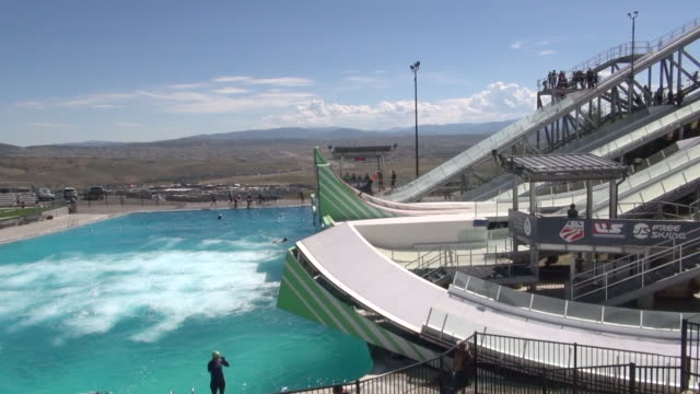 us national freestyle ski and snowboard team flies high off of the man made jumps at spence eccles olympic freestyle pool at utah olympic park the... - park city utah video stock e b–roll