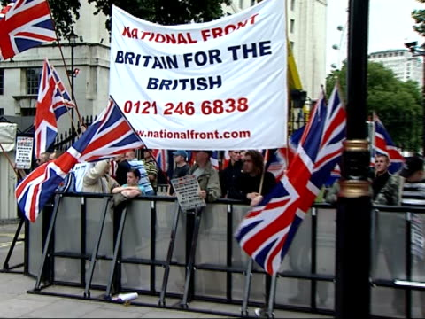 national front and radical muslim demonstrations in whitehall england london whitehall ext members of the national front protesting including waving... - national front stock videos & royalty-free footage
