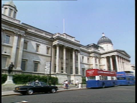 national gallery extention: the sainsbury wing; england: london: trafalgar square windows of national gallery l-r more ditto to wall with 'sainsbury'... - critic stock videos & royalty-free footage