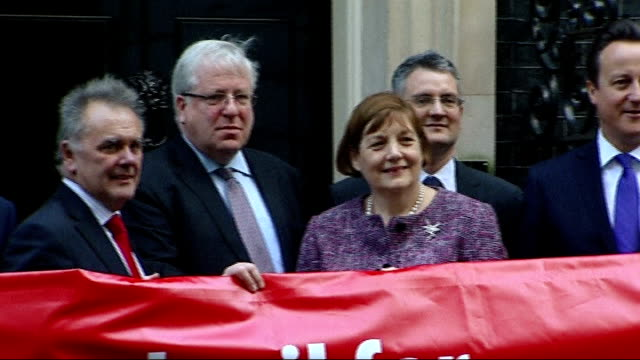 national grid profits / david cameron 'green crap' row downing street david cameron mp and ministers posing outside number 10 with banner 'high speed... - patrick mcloughlin stock videos and b-roll footage