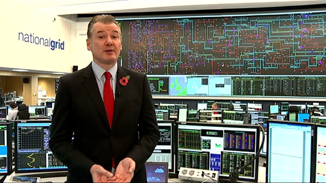 National Grid warns of energy blackouts National Grid Control Centre INT Reporter to camera Close shot screen showing information on National Grid...