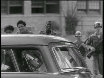 national guard escorting black teen students to car / little rock, arkansas - 1957 stock videos & royalty-free footage