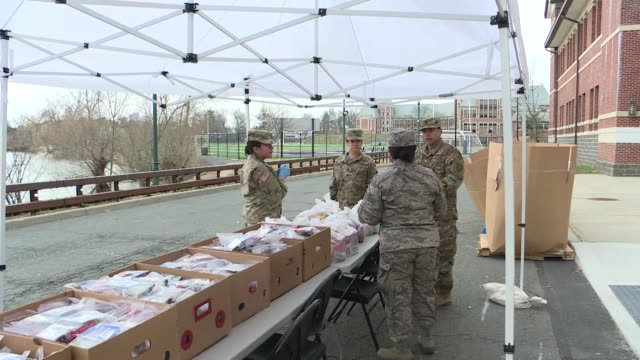 national guard is deployed to sterilize public spaces, deliver food to households in new rochelle, in the southeastern portion of the state on march... - new york stato video stock e b–roll