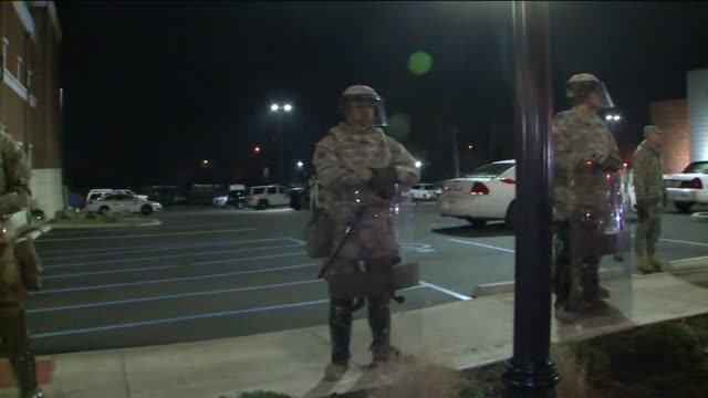 national guard lined up in front of ferguson police department the day after darren wilson grand jury decision in ferguson missouri on nov 11 2014 - national guard stock videos and b-roll footage
