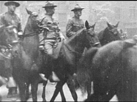 national guard or state militia marching in street soldiers on horseback ha td soldiers w/ bayonets on rifles soldier setting up machine gun behind... - 1910 1919 stock videos and b-roll footage