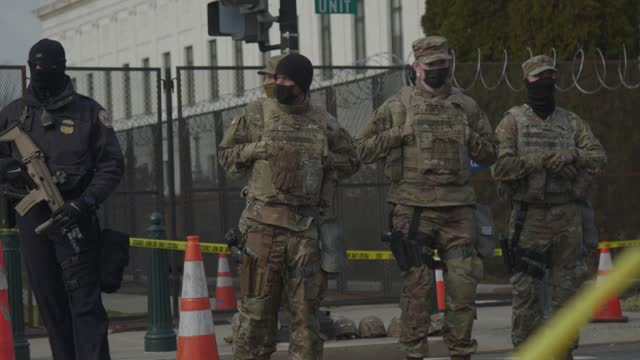 national guard patrol at a checkpoint at the u.s. capitol on january 17, 2021 in washington, dc. there are 25,000 national guard protecting the... - four people stock videos & royalty-free footage